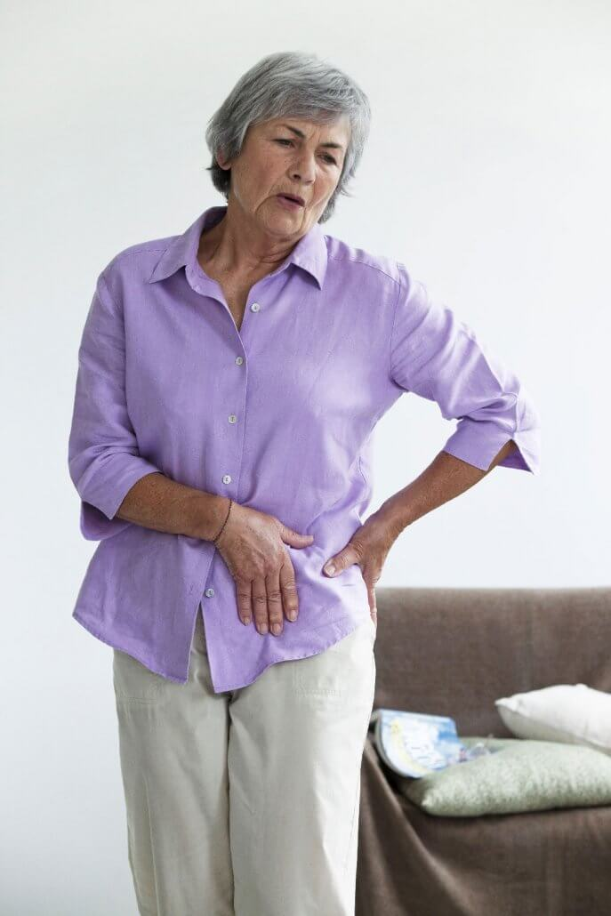 Senior woman experiencing hip pain