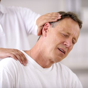 Cervical Spondylosis treatment: Chiropractor doing neck adjustment