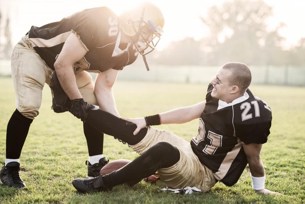 Football player with knee ligament injury