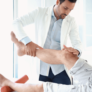 Surgeon examining knee ligament