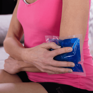 Woman icing elbow pain