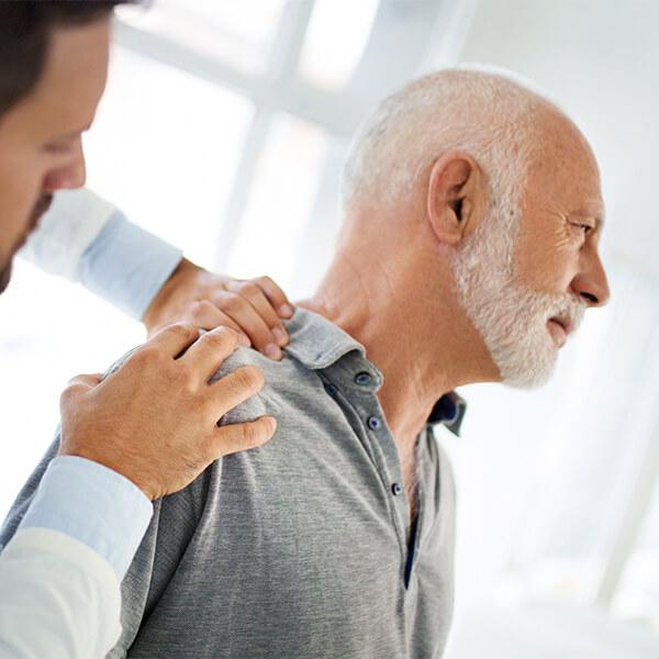Man getting treatment from shoulder arthritis