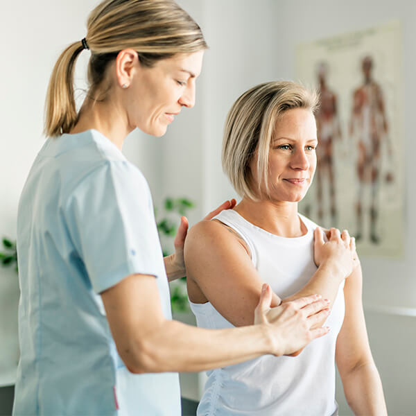 Woman getting examined for shoulder instability or a labral tear