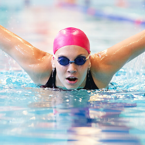 Woman swimming after receiving treatment for shoulder instability