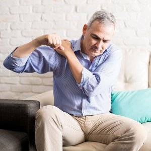 Man experiencing pain from shoulder arthritis