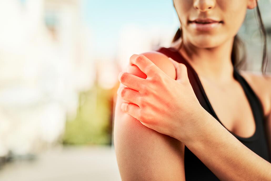 Woman suffering from rotator cuff tear